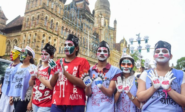 Students from various colleges participate in a peace rally on the 74th anniversary of \'Hiroshima Day\', in Mumba. PTI Photo