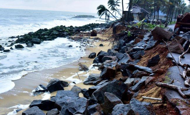 Sand sinks as sea erosion near Someshwar, Battampady. DH Photo