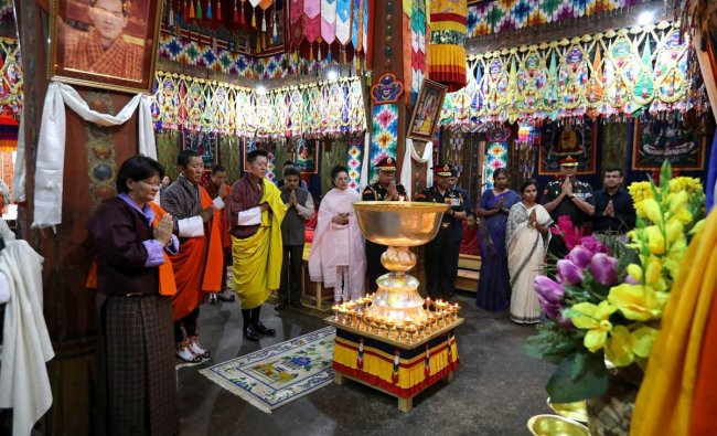 The portrait of former Indian foreign minister Sushma Swaraj is seen as Bhutan King Jigme Khesar Namgyel Wangchuck (unseen) offers prayers and butterlamps to her, at Simtokha Dzong in the Thimphu valley. AFP Photo