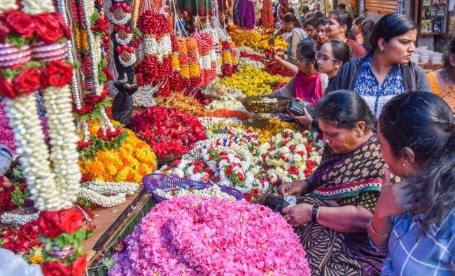 Women purchasing flowers on the eve of Varamahalakshmi festival at Gandhi Bazaar in Bengaluru on Thursday. (DH Photo   S K Dinesh)