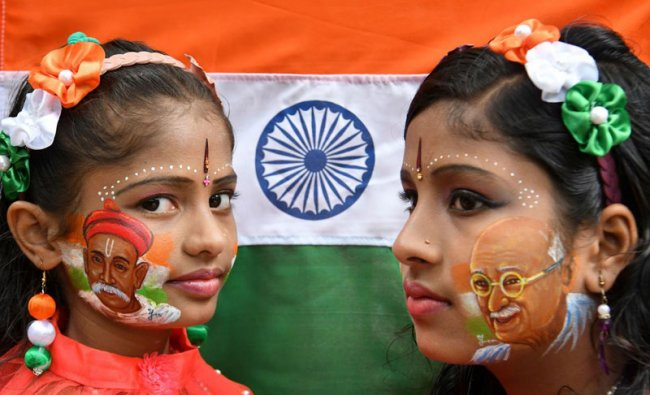 Siblings pose for a picture with their face painted depicting Indian freedom fighters Bala Gangadhara Tilak (L) and Mahatma Gandhi during the India\'s 73rd Independence Day, August 15, 2019. (Photo: AFP)