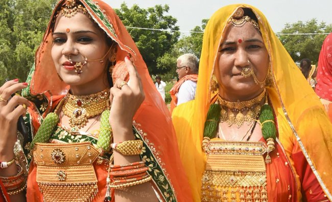 Bishnoi community women during a fair to offer tribute to legendary nature lover Amrita Devi Bishnoi and other martyrs, at Khejarli village in Jodhpur, Sunday, Sept 19, 2018. (PTI Photo)