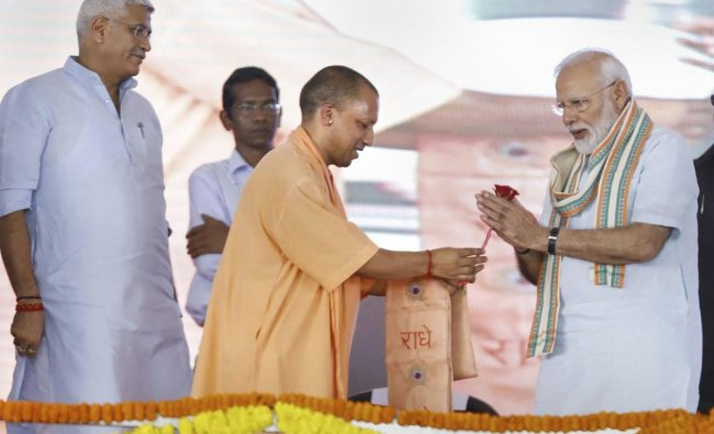 Prime Minister Narendra Modi and Uttar Pradesh Chief Minister Yogi Adityanath during launch of National Animal Disease Control Programme for eradication of Foot and Mouth Disease and Brucellosis in livestock, in Mathura. PTI