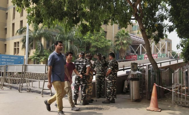 Security personnel guard outside the Jai Prakash Narayan Apex Trauma Centre of AIIMS, in New Delhi. A trial court hearing the Unnao rape case is holding in-camera proceeding inside the trauma centre to record testimony of the victim of the case. PTI