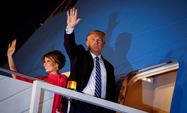 U.S. President Donald Trump and first lady Melania Trump wave as they board Air Force One as they conclude their two day visit to India, at Air Force Station Palam in New Delhi. (Reuters photo)