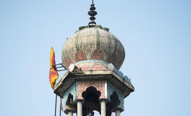 A minaret of a burnt-out mosque following clashes between people supporting and opposing a contentious amendment to the citizenship law, in New Delhi. (AFP Photo)