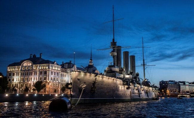 Aurora museum ship is docked at Neva river bank in Saint Petersburg during the early hours of June 22, 2017. In 1917 Aurora\'s gun signaled the start of the assault on the Winter Palace in St.Petersburg, which was the beginning of the October Bolshevik Revolution in Russia. AFP Photo