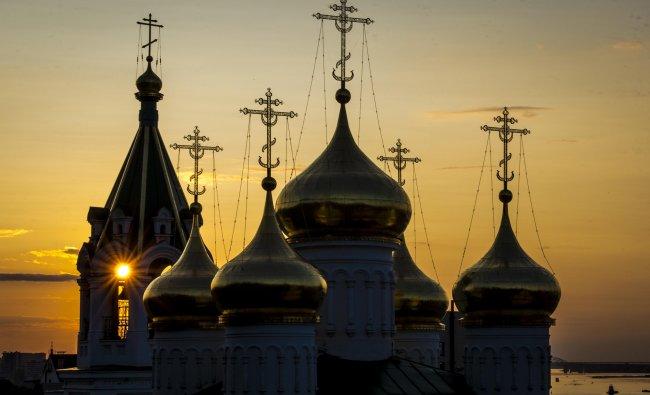 The sun sets behind the Rozhdestva Ioanna Predtechi church in Nizhny Novgorod on August 26, 2017. Nizhny Novgorod will host several matches of the 2018 FIFA World Cup football tournament. AFP Photo