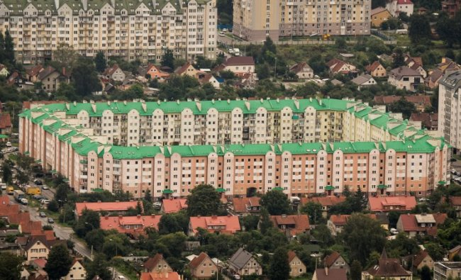 An aerial photo taken on August 27, 2017 shows an apartment complex in Kaliningrad. Kaliningrad Stadium will host several games of the FIFA World Cup 2018. AFP Photo