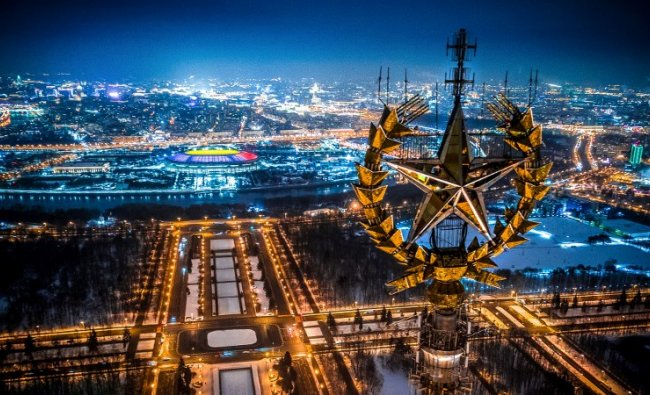 An aerial view taken with a drone in Moscow on January 27, 2018 shows a star on top of the Moscow State University, Luzhniki Stadium and the Moskva River. AFP Photo