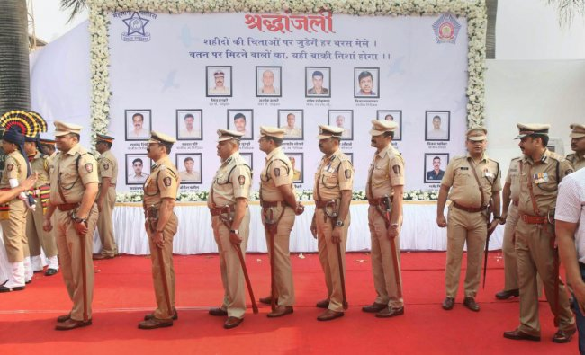 Mumbai Police personnel pay their tribute to martyrs of the 26/11 terror attacks on its tenth anniversary, at the Martyrs\' Memorial, Police Gymkhana, in Mumbai, Monday, Nov. 26, 2018. On November 26, 2008, 10 Pakistani terrorists arrived by sea route and opened fire indiscriminately at people killing 166, including 18 security personnel, and injuring several others, besides damaging property worth crores. (PTI Photo)