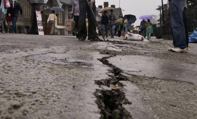 Cracks appear on a ridge in Shimla as rains continued to lash the city on Monday...