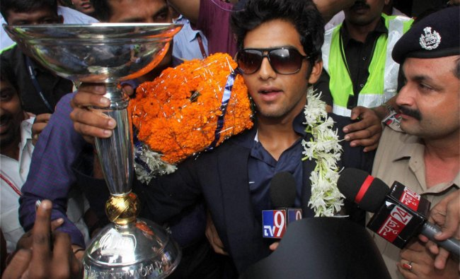 Under-19 Team India captain Unmukt Chand being welcomed on his arrival at the airport in Mumbai...
