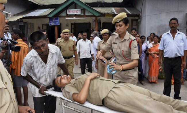 A female police official after she was attacked by All Assam Minority Students\' union in Assam...