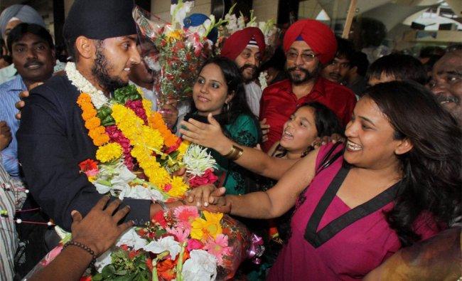 Under 19 Team India player Harmeet Singh Baddan being welcomed on his arrival in Mumbai...