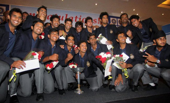 Under-19 World Cup winning team members pose for a photograph...