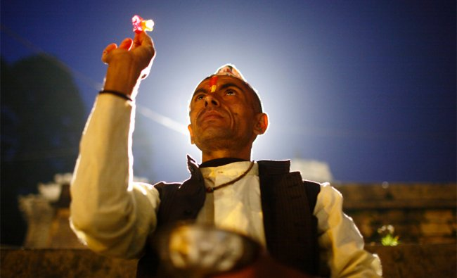 A priest offers prayers along the banks of the Bagmati River, during the Rishi Panchami, Nepal...