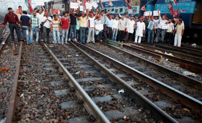 Samajwadi Party activists protest along railway tracks in Allahabad...