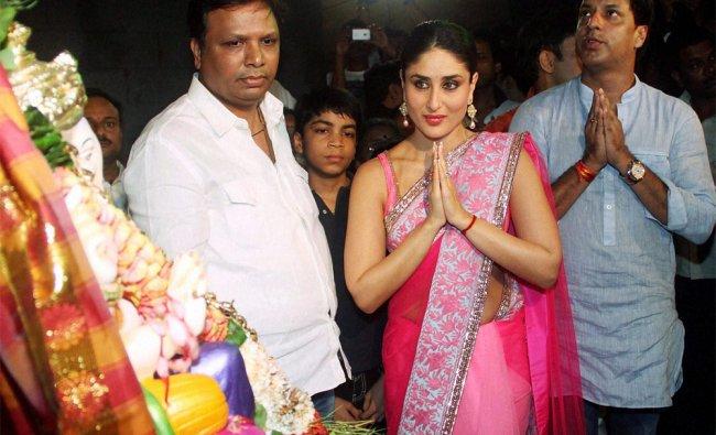 Mumbai: Director Madhur Bhandarkar and actress Kareena Kapoor perform worship of Lord Ganesh...