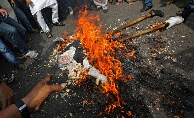 Activists of India\'s main opposition Hindu nationalist Bharatiya Janata Party (BJP) burn an effigy..