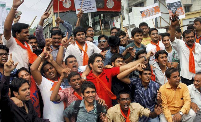 BJP workers stop the traffic during their nationwide protest against FDI in retail and fuel price...