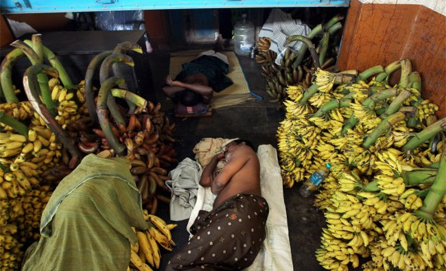 Workers take rest at their shop at Koyambedu market in Chennai during Bharat bandh protest over FDI.