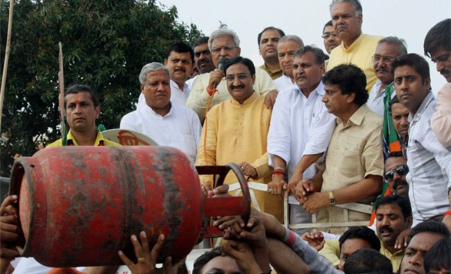 UP BJP Chief Lakshmikant Vajpayee, Ramesh Pokhriyal and other leaders holding a protest....