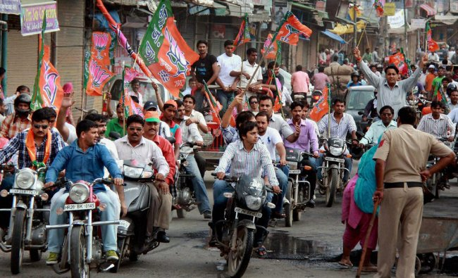 BJP activists take out a bike rally during their protest against FDI
