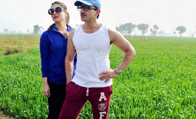 Bollywood actor Saif Ali khan and Kareena Kapoor pose for a photo in the field of wheat at Pataudi..