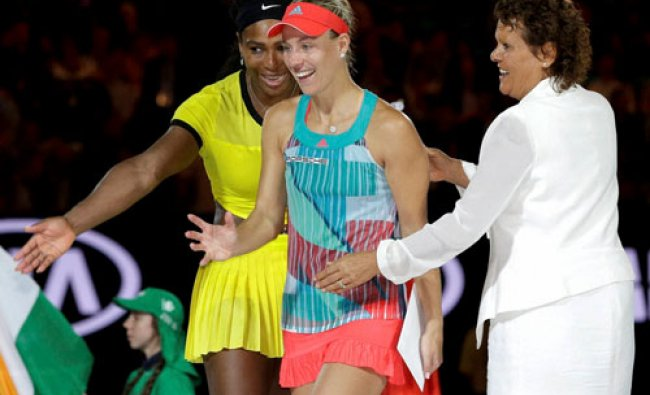 Angelique Kerber, center, of Germany is assisted Serena Williams, left, of the United States and ...