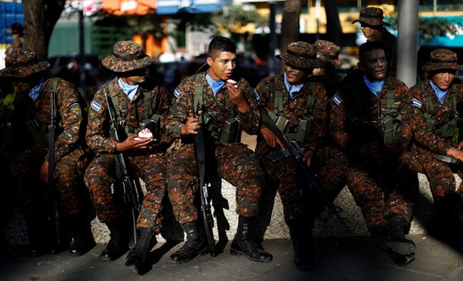 Salvadoran soldiers gather before a ceremony to deploy military personnel to support a security plan in San Salvador, El Salvador. (Reuters Photo)