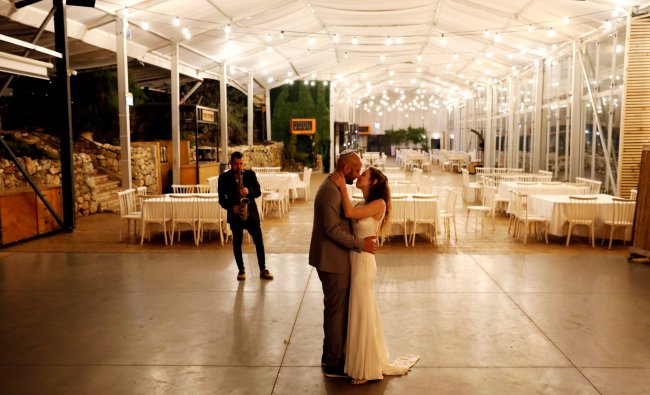 Israeli couple Roni Ben-Ari and Yonatan Meushar, dance as they get married at Ein Hemed Forest Wedding Venue in Israel. (Credit: Reuters)
