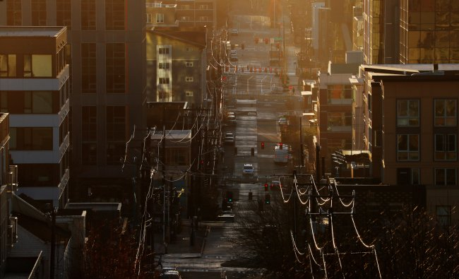 The sun sets in a deserted Seattle. (Credit: Reuters)