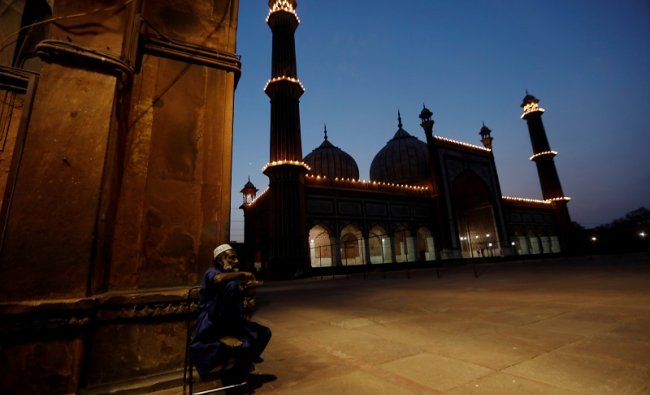 Security personnel stand guard at Jama Masjid area on the first day of holy month of Ramzan during a nationwide lockdown, in New Delhi. (AFP Photo)