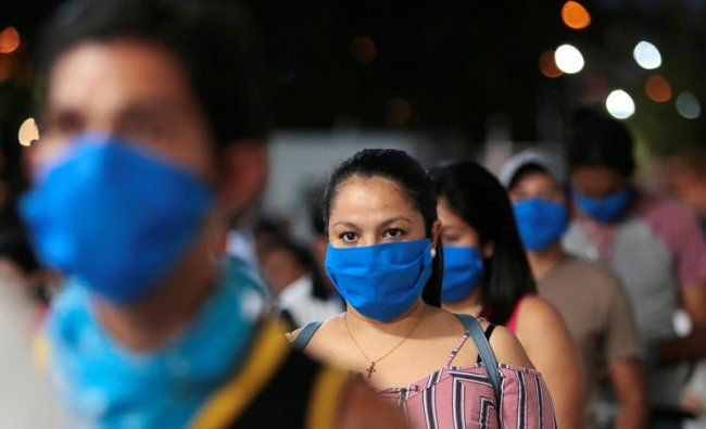 Fans wearing face masks while entering the arena, despite most sport being cancelled around the world as the spread of the coronavirus disease (COVID-19) continues. (Reuters Photo)