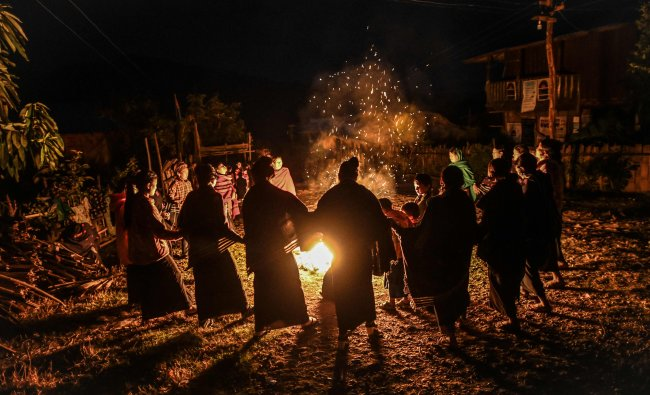 Naga tribeswomen taking part in an overnight ceremony to bless the harvest in Satpalaw Shaung village, Lahe township in Myanmar\'s Sagaing region. - A haunting refrain pierces the night as the tribeswomen of the Gongwang Bonyo, among the most isolated people in Myanmar, dance around a campfire to bless the harvest ahead. (AFP Photo)