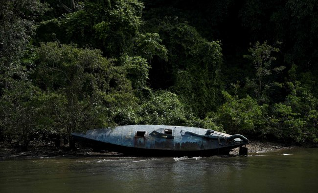 A homemade narco-submarine that has been seized is seen at the seaport of the Colombian Coast Guard in Tumaco, Colombia. (Credit: AFP)