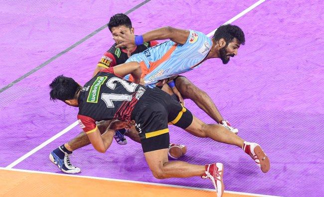 Bengaluru Bulls player Amit Sheoran and teammate try to tackle Bengal Warriors player Sukesh Hegde during the 7th season of Pro Kabaddi league match, at Netaji Indoor Stadium in Kolkata. PTI