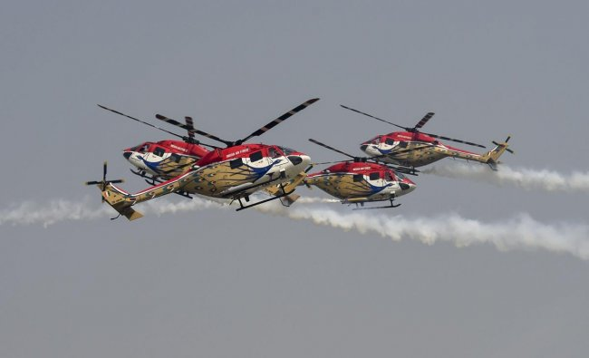 \'Sarang\' helicopter aerobatic team of Indian Air Force performs at the 86th Air Force Day Parade 2018, at Air Force Station, Hindon in Ghaziabad. (PTI photo)