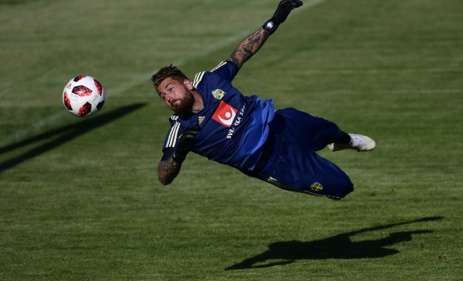 Sweden\'s goalkeeper Kristoffer Nordfeldt dives during a training session at Spartak stadium in Gelendzhik during the Russia 2018 World Cup football tournament. Credit: PIERRE-PHILIPPE MARCOU / AFP