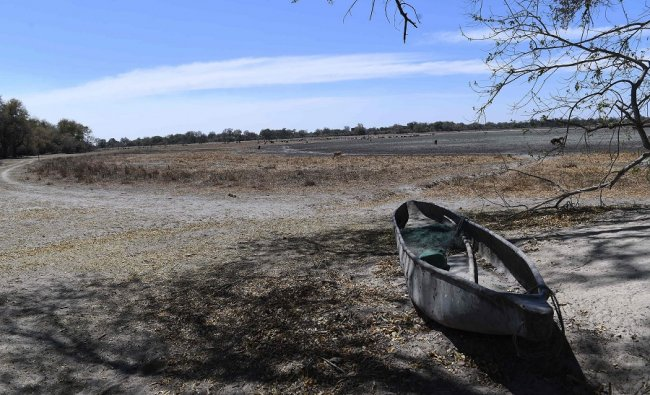 A traditional boat is seen at the shore of one of the channel of the wildlife reach Okavango Delta near the Nxaraga village in the outskirt of Maun. (AFP)