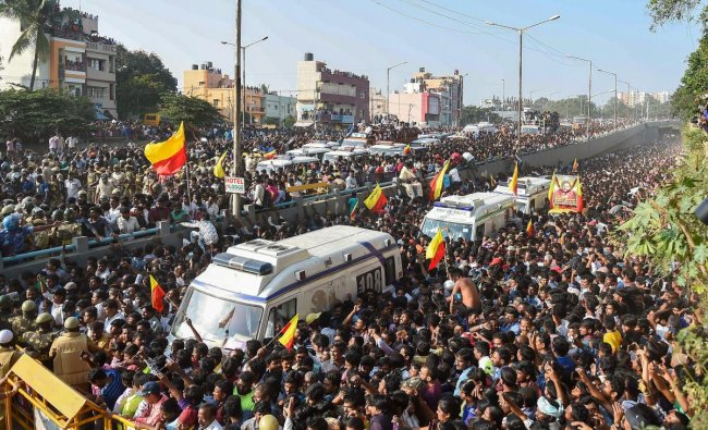 Bengaluru: Crowd of fans gather at Kanteerava Studio during the funeral procession of the veteran Kannada actor and politician Ambarish, in Bengaluru, Monday, Nov. 26, 2018. The actor passed away Sunday at the age of 66. (PTI Photo/Shailendra Bhojak)