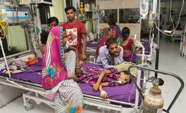Children showing symptoms of Acute Encephalitis Syndrome (AES) being treated at Shri Krishna Medical College and hospital in Muzaffarpur, Sunday, June 16, 2019. With one more death of a child on Sunday morning, the death toll in the district rose to 83 this month. PTI