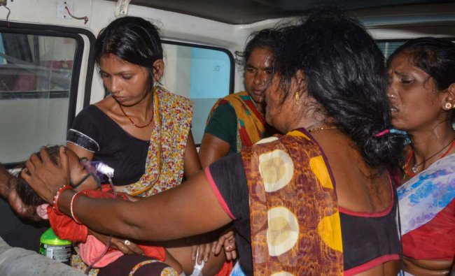A child showing symptoms of Acute Encephalitis Syndrome (AES) arrives for treatment at a hospital in Muzaffarpur, Wednesday, June 19, 2019. The official figure of deaths is 105, with both the SKMCH hospital and the privately owned Kejriwal hospital in Muzaffarpur reporting one casualty during the night. PTI