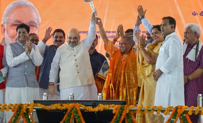 BJP National President Amit Shah (2ndR), Railway Minister Piyush Goyal(L) and Uttar Pradesh Chief Minister Yogi Adityanath (3rdL) during the inauguration of a new train at Pandit Deen Dayal Upadhyay station (previously known as Mughalsarai railway station), in Mughalsarai on Sunday. PTI photo