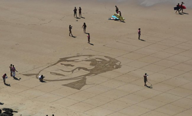 A portrait of German Chancellor Angela Merkel is the first drawing of G-7 leaders drawn into the sand in Biarritz, France Friday, on Aug. 23, 2019. (AP/PTI)