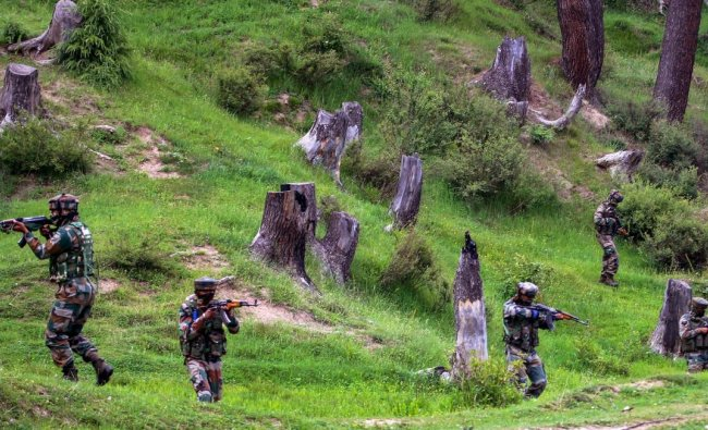 Army personnel take positions during an encounter with the militants in Keran Sector of Kupwara district of north Kashmir on Sunday, June 10, 2018. The Army foiled an infiltration bid along the Line of Control (LoC) in Keran sector of Jammu and Kashmir, killing Six militants. PTI Photo