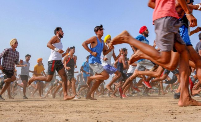 Candidates run during a physical fitness test in an army recruitment rally at Khasa, approximately 15 Kms from Amritsar on Saturday. (AP/PTI Photo)