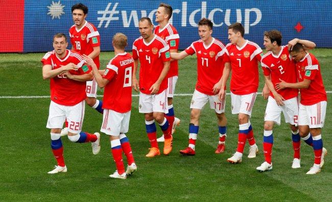 World Cup - Group A - Russia vs Saudi Arabia : Russia\'s Artem Dzyuba celebrates scoring their third goal with team mates in Luzhniki Stadium, Moscow, Russia.REUTERS