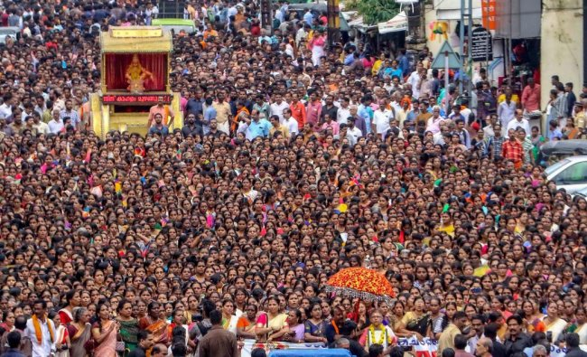 Hundreds of devotees, mostly women, take part in the \'namajapa\' (chanting the name of Lord Ayyappa ) during a march in Kottayam. (PTI Photo)